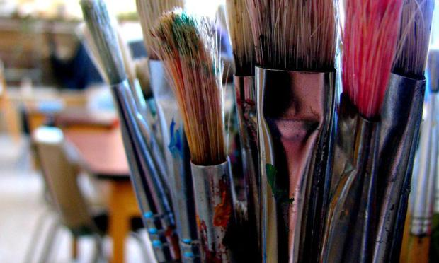 Paintbrushes in a classroom.