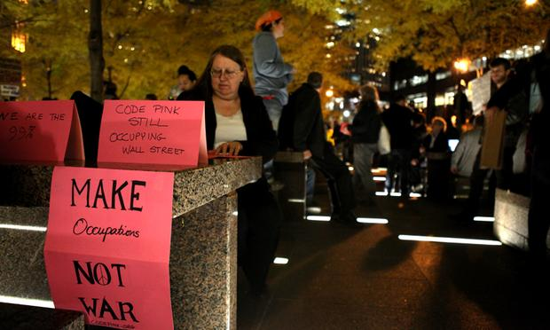 Members of Code Pink set up a table soon after returning to Zuccotti Park.