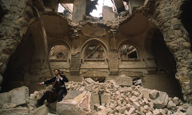 Vedran Smajlovic performs in 1992 in Sarajevo in the partially destroyed National Library