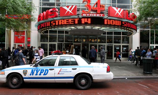 Extra police are outside of New York City movie theaters on opening night of 'The Dark Knight Rises.'