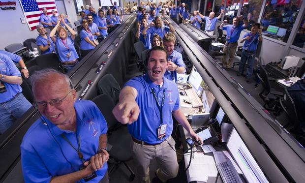 NASA/JPL ground controllers react to learning the the Curiosity rover had landed safely on Mars and begun to send back images to NASA's Jet Propulsion Laboratory on Sunday, Aug. 5, 2012.