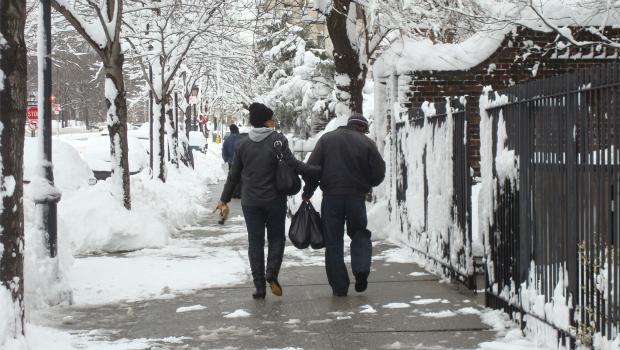 A couple makes their way through the snow in Prospect Heights, Brooklyn on January 27.