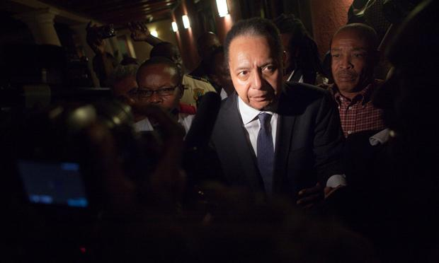 Jean-Claude Duvalier,  the former Haitian leader known as 'Baby Doc', makes his way back into the Hotel Karibe after being questioned by Haitian authorities at a downtown courthouse January 18, 2011