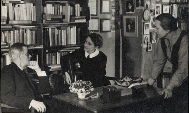 The author James Joyce photographed with Sylvia Beach and Adrienne Monnier at Shakespeare & Co. in Paris in 1920.