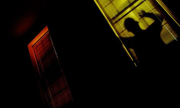 Man lurking at window