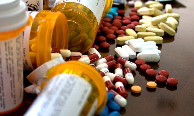 pills spilling out of bottles
