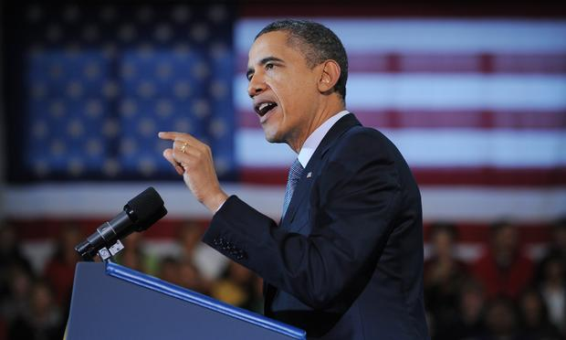 President Barack Obama speaks on the economy and an extension of the payroll tax cut at Osawatomie High School December 6, 2011 in Osawatomie, Kansas.
