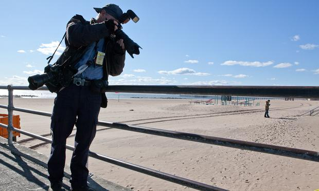 New York Daily News photographer Todd Maisel shooting a crime scene at Coney Island.