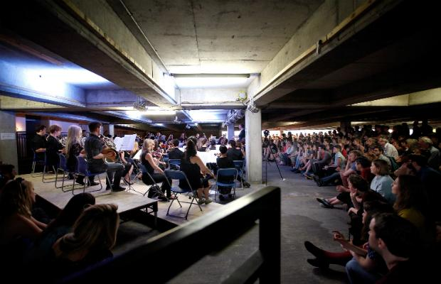 The Multi-Story Orchestra perform Jean Sibelius' 5th Symphony at the Peckham Rye Car Park on June 21, 2014 in London, England.
