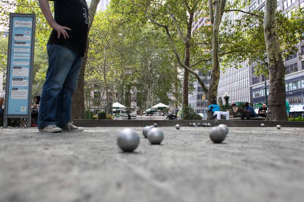 Petanque players in Bryant Park take advantage of the lazy afternoons to work on their game in late August.