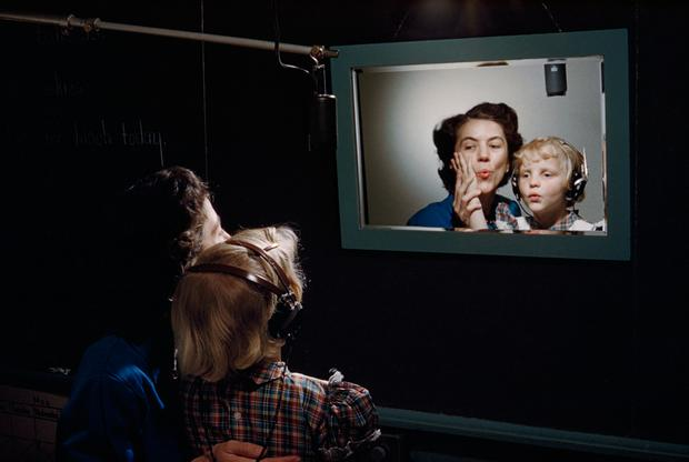 A teacher and a deaf student practice making sounds in front of mirror at the Clarke School for the Deaf in Massachusetts, March 1955. (Photograph by Willard Culver, National Geographic)