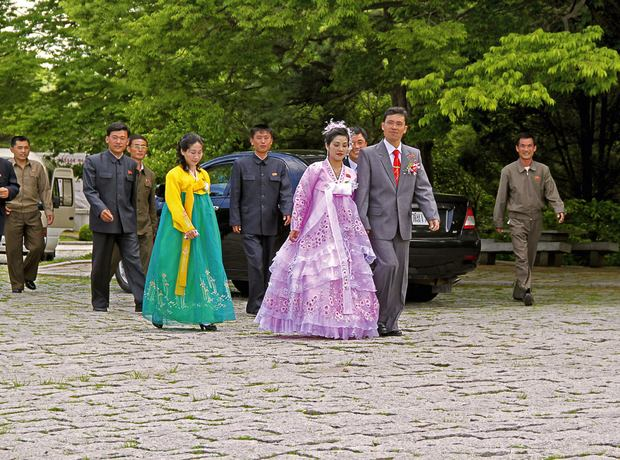 A rare sight: A bride wearing a traditional dress in the seaport of Nampho. From North Korea: Anonymous Country by Julia Leeb.
