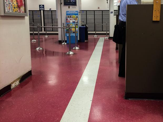 A West Village post office is unusually quiet in August.