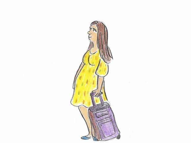 A pregnant woman boards a plane.