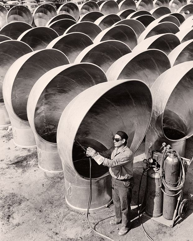 A welder works on cowls for liberty ships in California, 1942. (Photograph by Acme News Pictures, Inc.)