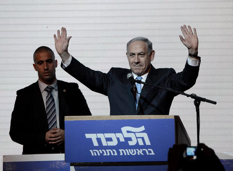 Israeli Prime Minister and the leader of the Likud Party Benjamin Netanyahu greets supporters at the party's election headquarters after the first results of the Israeli general election. 3/18/15