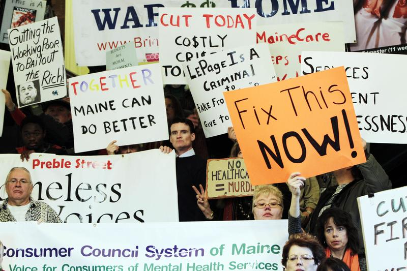 Dozens join in a rally voicing their concerns about proposed budget cuts in the Medicaid system, during a rally at the State House in Augusta, Maine, on Wednesday, Dec. 14, 2011.