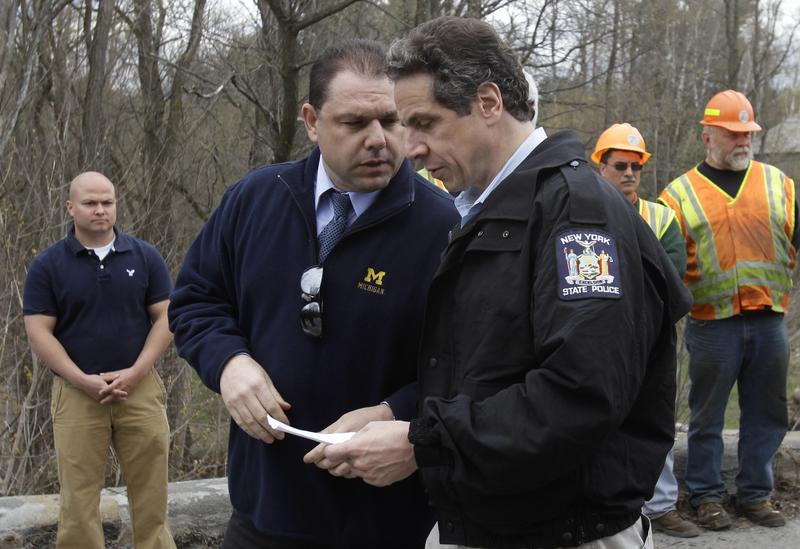 New York Gov. Andrew Cuomo, right, and aide Joseph Percoco tour an area hit by a spring storm in Moriah, N.Y., on Friday, April 29, 2011.
