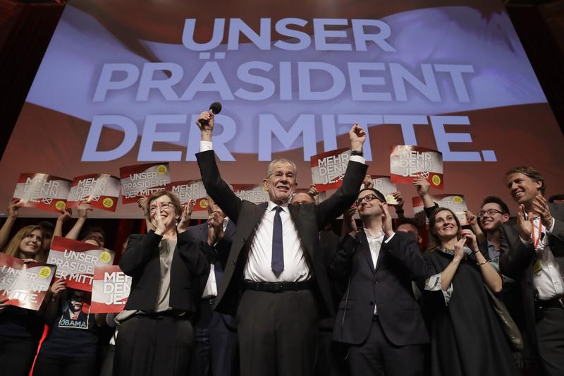 Presidential candidate Alexander Van der Bellen, a former leading member of the Greens Party, celebrates on the podium at a party of his supporters in Austria's capital Vienna Sunday, Dec. 4, 2016.
