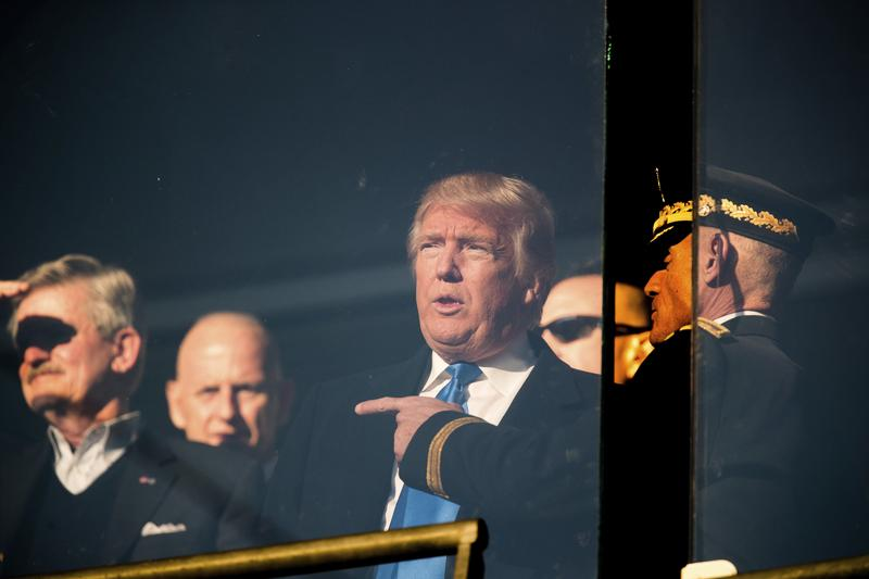 President-elect Donald Trump, center, speaks with members of the military in a box in the stands during the Army-Navy NCAA college football game at M&T Bank Stadium, Saturday, Dec. 10, 2016.