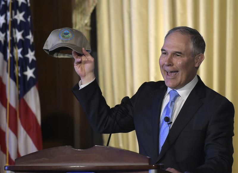 Environmental Protection Agency (EPA) Administrator Scott Pruitt holds up a hat that was presented to him before speaking to employees of the EPA in Washington, Tuesday, Feb. 21, 2017.