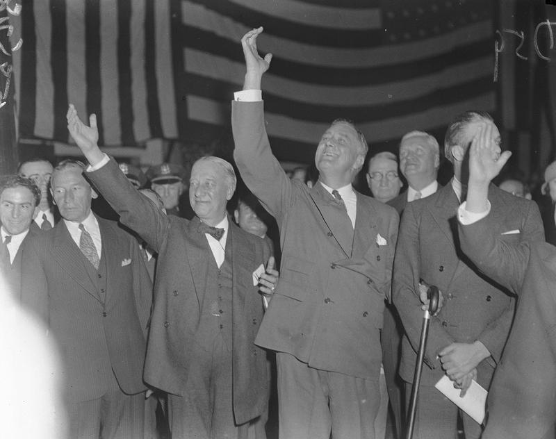 New York Gov. Franklin D. Roosevelt and former New York Gov. Alfred E. Smith acknowledge an enthusiastic crowd at the Brooklyn Academy of Music in the Brooklyn borough of New York City, Nov. 4, 1933.