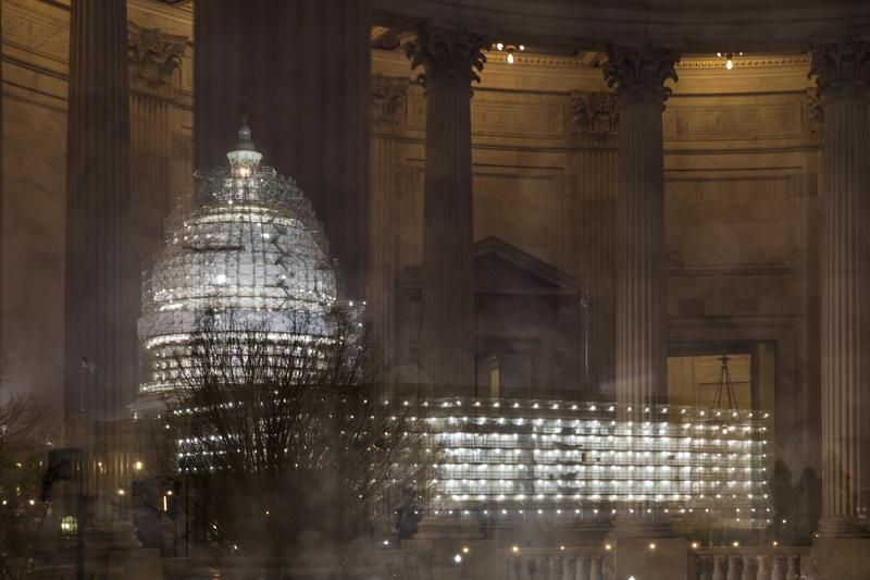 The Capitol in Washington is illuminated during a thunderstorm with the rotunda of the Russell Senate Office Building reflected on the rain-covered windows, late Wednesday afternoon, Feb. 24, 2016.