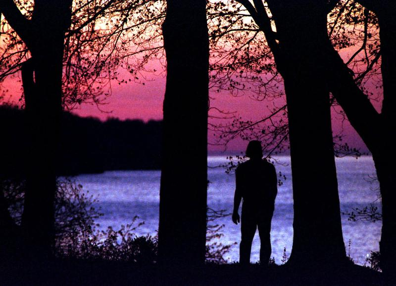 A man enjoys the sunset while taking a walk along Lake Erie in the Cleveland Metro Parks Huntington Beach Park in Bay Village, Ohio, Monday, May 3, 1999.