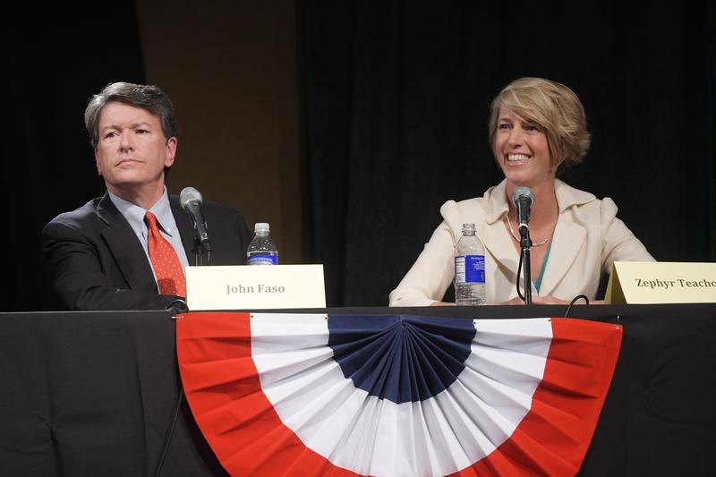 Republican John Faso, left, and Democrat Zephyr Teachout, right, take part in a debate at WAMC's Performing Arts Center on Thursday, Sept. 15, 2016, in Albany, N.Y.
