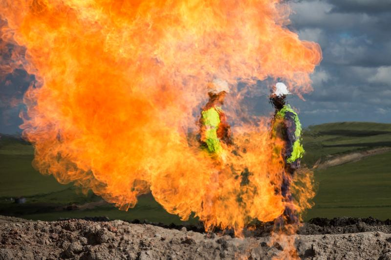A gas flare is seen at an oil well site on July 26, 2013 outside Williston, North Dakota.