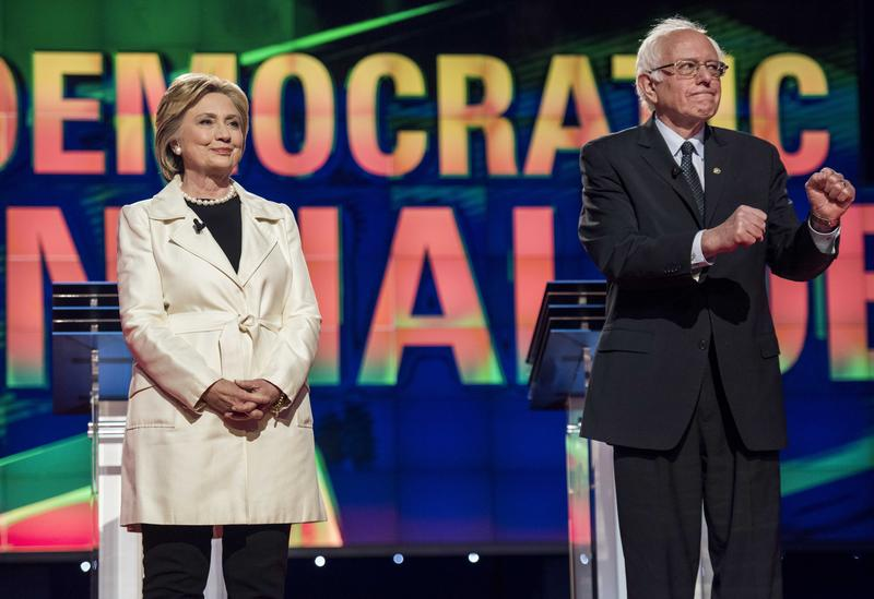 Former Secretary of State Hillary Clinton and Senator Bernie Sanders appear on stage before the CNN Democratic Presidential Primary Debate at the Brooklyn Navy Yard in Brooklyn, New York. 04/14/2016
