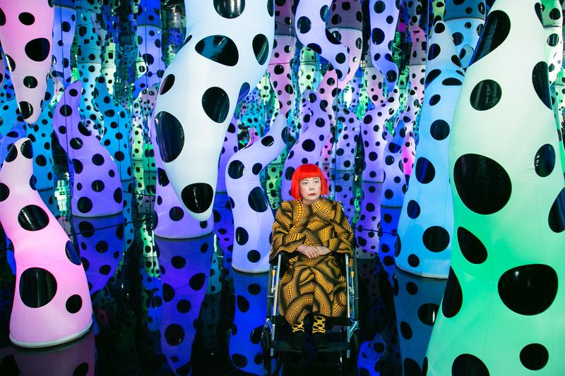 "Yayoi Kusama inside her room installation ""Love is Calling"""