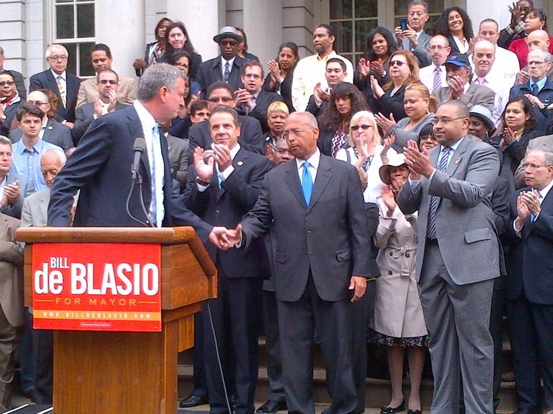 Democrat Bill de Blasio, public advocate, turns to shake hands with Bill Thompson after he bows out of mayoral race