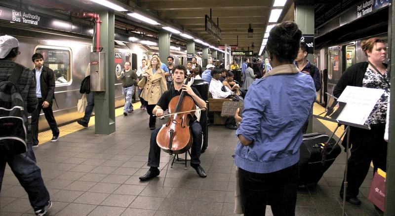 Cellist Dale Henderson, founder of Bach in the Subways Day, plays in the Times Square subway on March 21, 2012.