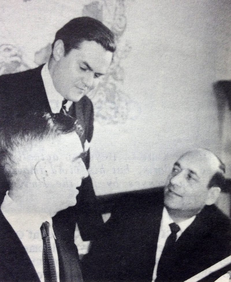 Bob Sweeney (standing) swaps stories about khrushchev and the communist countries with OPC head Barrett McGurn and Jess Gorkin at the Overseas Press Club.