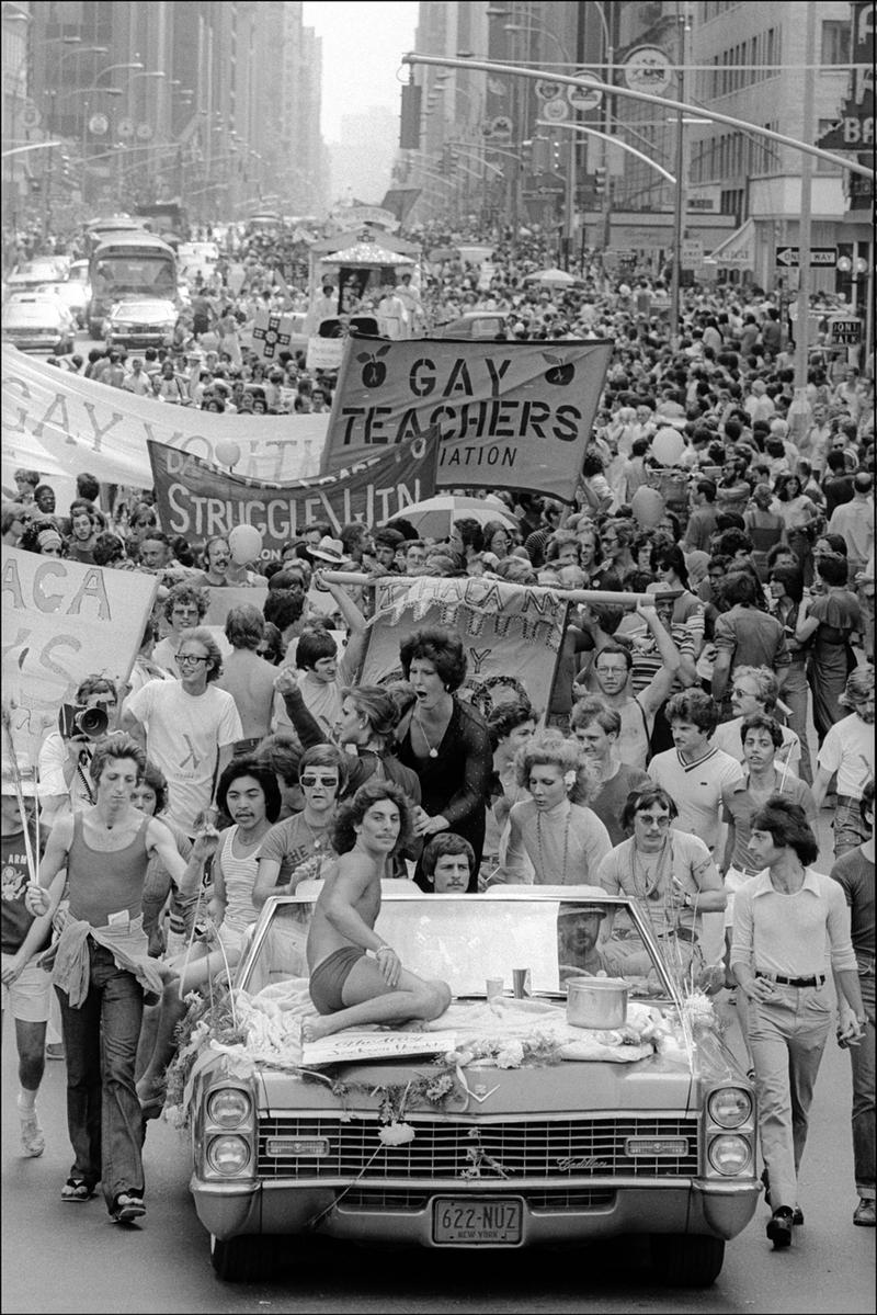 View along 6th Avenue as hundreds of people march (and drive) towards Central Park in a Gay Pride Parade, New York, New York, June 26, 1975.