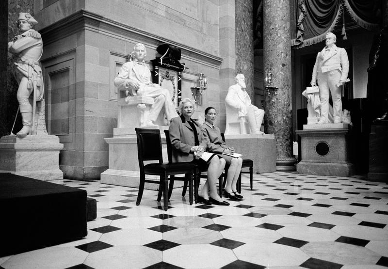 The only two female Justices of the U.S. Supreme Court, Sandra Day O'Connor and Ruth Bader Ginsburg, pose for a portrait surrounded by statues of men at the U.S. Capitol Building in Washington, D.C.