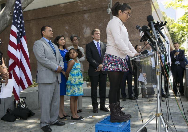 Student Julia Macias, right at lectern, a plaintiff and Los Angeles Unified School District Middle School, comments on the Vergara v. California lawsuit verdict in Los Angeles on June 10. Others from left, parents, Joe Macias, with wife, Evelyn, and their daughter Lucy, Russlyn Ali, Former Assistant Secretary of U.S. Education Department Office for Civil Rights, and Students Matter Board member, with Founder David Welch. (Damian Dovarganes/AP Photo)