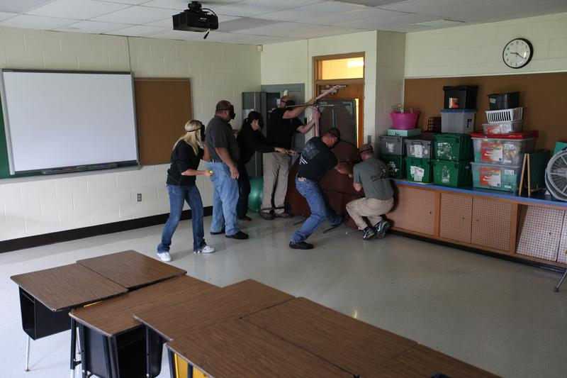 Students receive training for barricading a classroom door in the event of a shooter entering their school as part of the ALICE program. (ALICE Training Institute)