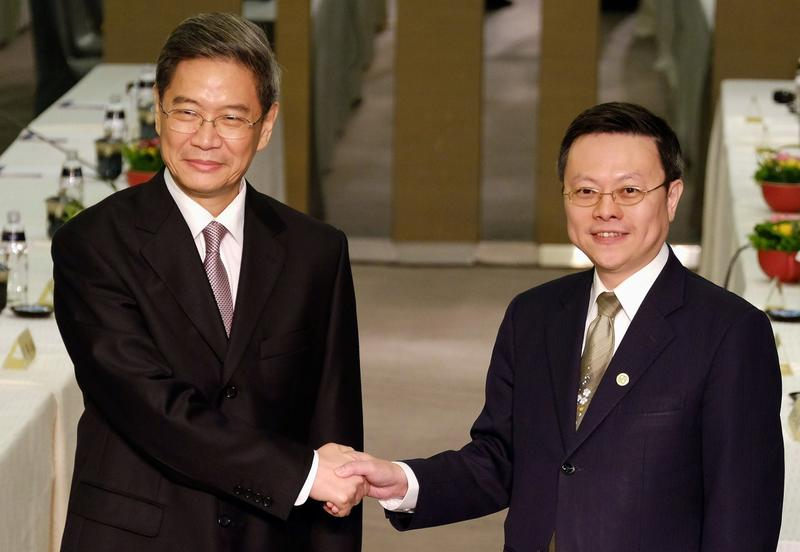 Chinese official Zhang Zhijun (left), director of the Taiwan Affairs Office, shakes hands with his Taiwanese counterpart Wang Yu-chi, director of Taiwan's Mainland Affairs Council, at a hotel in Taoyuan on June 25, 2014. (Sam Yeh/AFP/Getty Images)