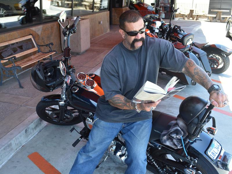 "Biker Ron Hamberg says he's read Dickens, Twain and Ghandi's autobiography, but as for books about motorcycles, ""I just ride 'em, I don't read about 'em."""
