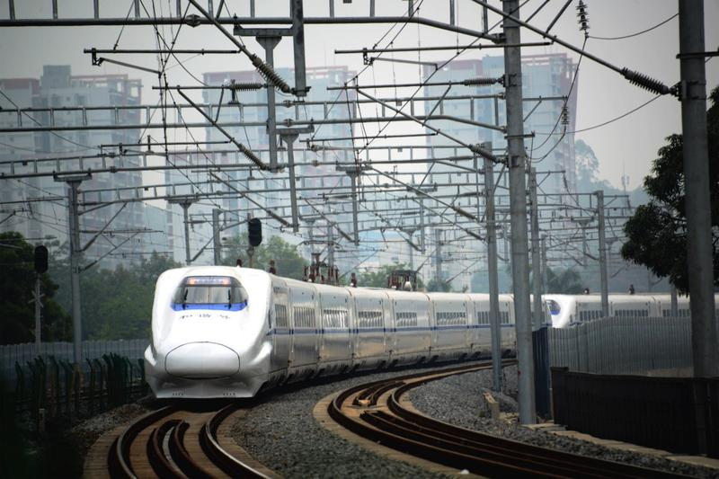 A high-speed train travels on the railway to Beijing in Nanning, southern China's Guangxi province on June 13, 2014. (AFP/AFP/Getty Images)
