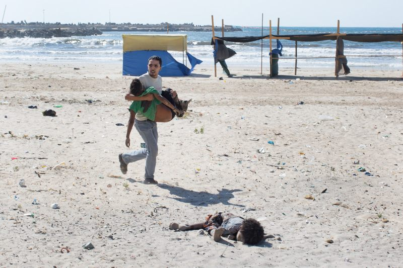 This photo by The New York Times' Tyler Hicks was taken shortly after Israeli ordnance struck a beach in Gaza City, killing four young boys and injuring one young adult, July 16, 2014. (Tyler Hicks/The New York Times)