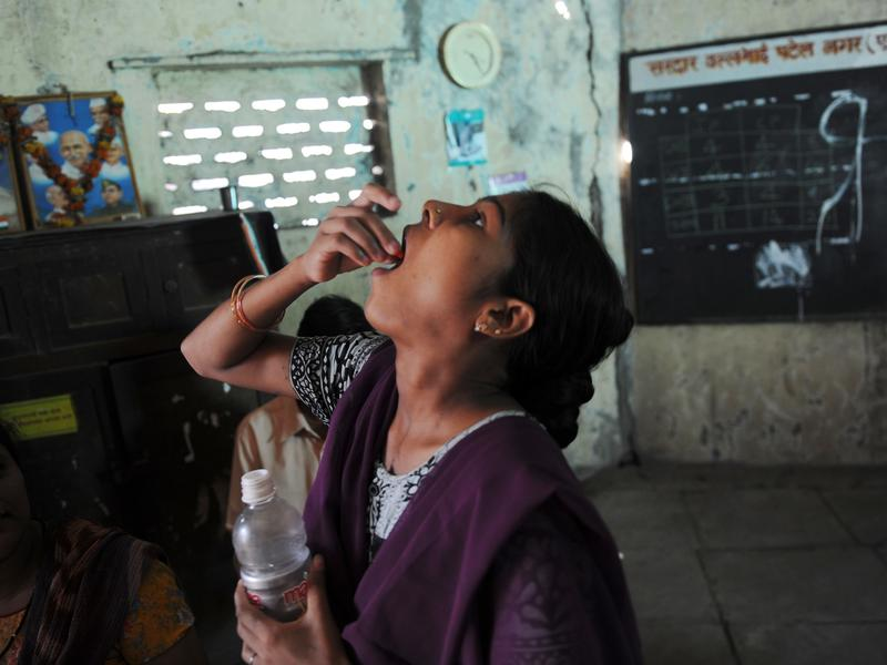 An Indian woman takes tuberculosis pills at a clinic in Mumbai. More than 700 Indians die from TB each day. That's one death every two minutes.