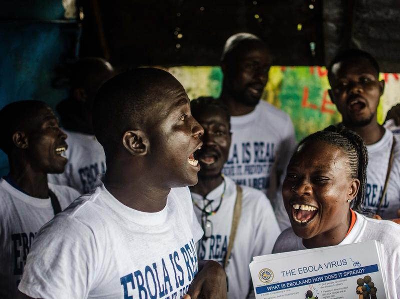 A group sings to raise awareness about Ebola in Monrovia's West Point neighborhood.