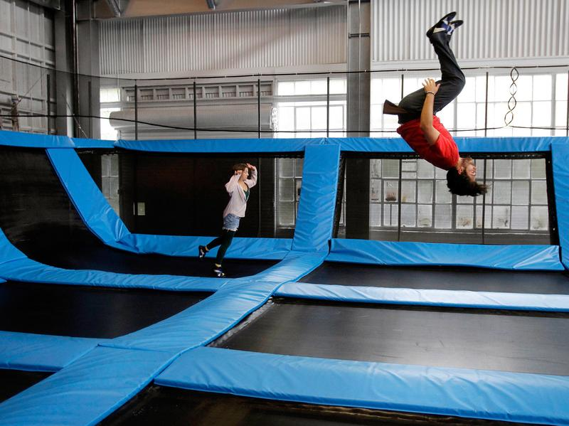 Trampoline parks like this one in San Francisco typically offer dodge ball and other activities on trampolines.