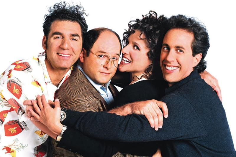 "The cast of ""Seinfeld,"" (L to R) Michael Richards as Cosmo Kramer, Jason Alexander as George Costanza, Julia Louis-Dreyfus as Elaine Benes and Jerry Seinfeld as the show's titular character. (Courtesy of NBC)"