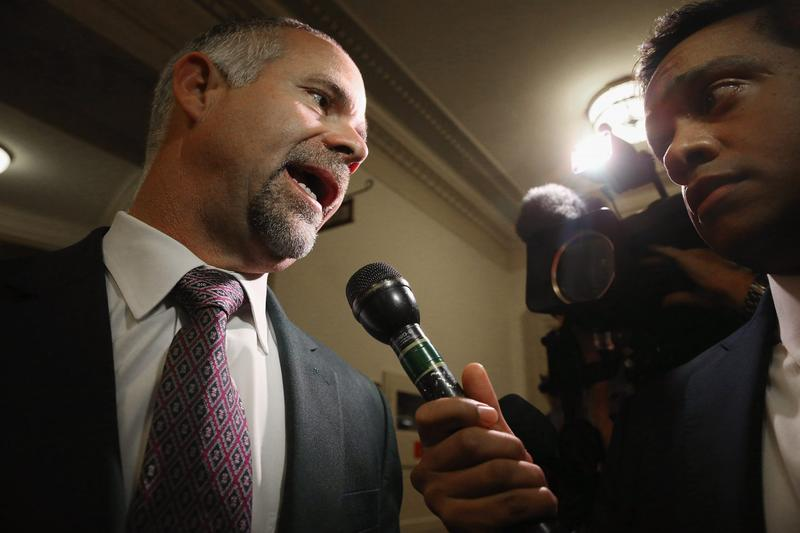 Rep. Tim Huelskamp (R-KS) (L) talks to reporters in the Longworth Building on Capitol Hill October 28, 2015 in Washington, D.C. (Chip Somodevilla/Getty Images)