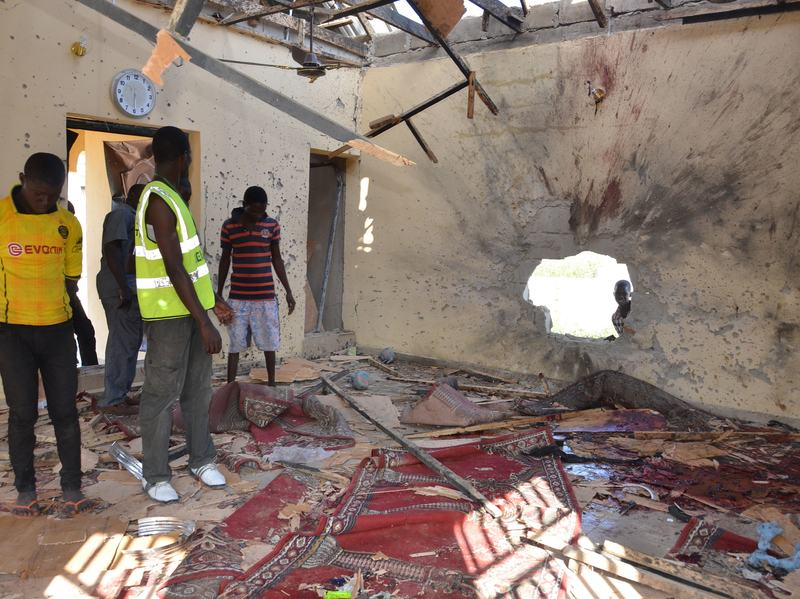 People inspect a damaged mosque following an October 2015 explosion in Maiduguri, Nigeria. Maiduguri is in Borno State, where Boko Haram was born.