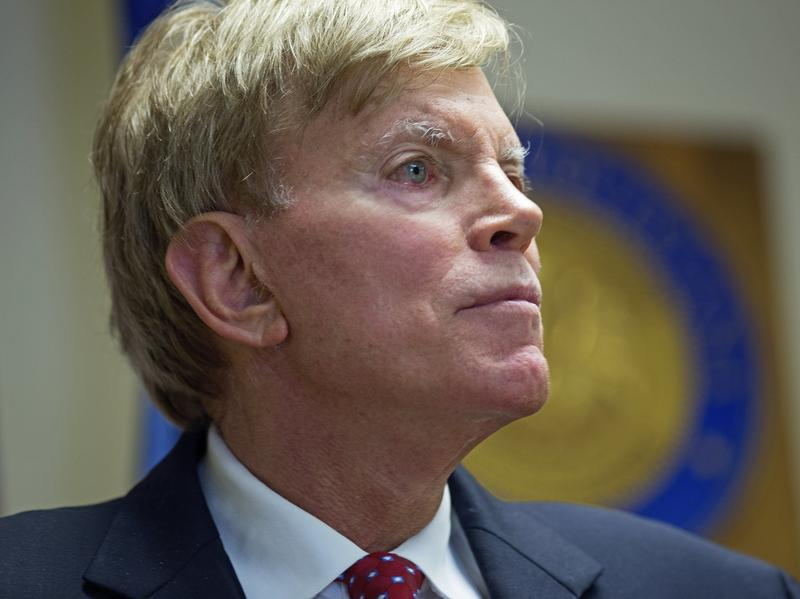 """Former Ku Klux Klan leader David Duke talks to the media at the Louisiana secretary of state's office in Baton Rouge, La., on July 22, after registering to run for the U.S. Senate. """"The climate of this country has moved in my direction,"""" Duke said as he announced his candidacy, one day after Donald Trump accepted the GOP nomination for president."""